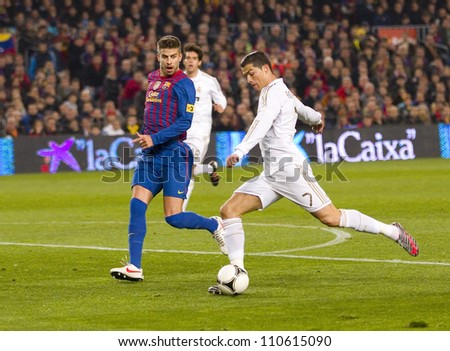 BARCELONA - JANUARY 25: Cristiano Ronaldo (R) of Madrid in action during the Spanish Cup match between FC Barcelona and Real Madrid, final score 2 - 2, on January 25, 2012, in Barcelona, Spain.