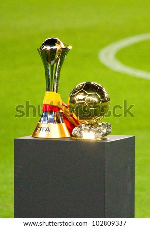 BARCELONA - JANUARY 15: FC Barcelona team offers the FIFA Club World Cup (L) and FIFA World Player Gold Ball Trophy to supporters, on January 15, 2012 in Nou Camp stadium, Barcelona, Spain.