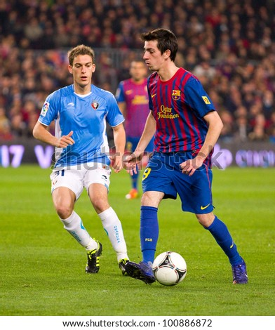 BARCELONA - JANUARY 4: Isaac Cuenca (R) of Barcelona in action at the Spanish Cup match between FC Barcelona and Osasuna, final score 4 - 0, on January 4, 2012 in Camp Nou stadium, Barcelona, Spain.