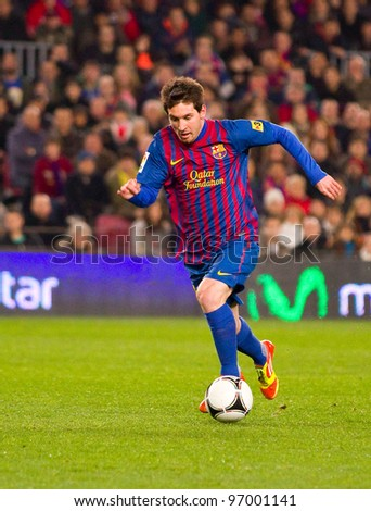 BARCELONA - JANUARY 4: Leo Messi of Barcelona in action during the Spanish Cup match between FC Barcelona and Osasuna, final score 4 - 0, on January 4, 2012 in Camp Nou stadium, Barcelona, Spain.