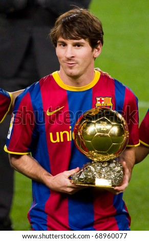 BARCELONA - JANUARY 12: Leo Messi offering the Gold FIFA World Player Trophy to the soccer supporters of Football Club Barcelona. January 12, 2011 in Nou Camp stadium, Barcelona (Spain). - stock photo