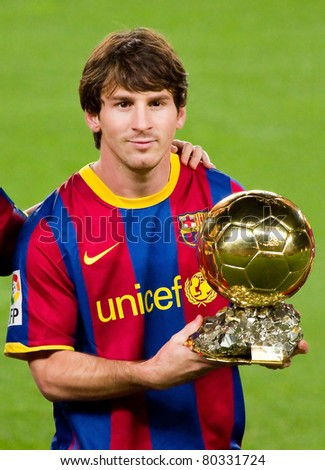 BARCELONA - JANUARY 12: Leo Messi offers the FIFA World Player Gold Ball Award to the supporters of Football Club Barcelona. January 12, 2011 in Nou Camp stadium, Barcelona, Spain.