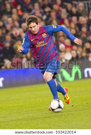 BARCELONA - JANUARY 4: Lionel Messi of Barcelona in action during the Spanish Cup match between FC Barcelona and Osasuna, final score 4 - 0, on January 4, 2012 in Camp Nou stadium, Barcelona, Spain.