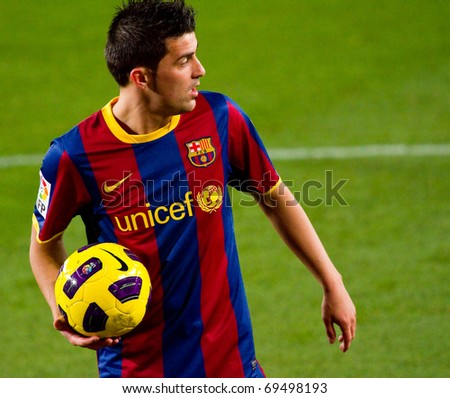 BARCELONA - JANUARY 16: Nou Camp football stadium, soccer Spanish League match: FC Barcelona - Malaga, 4 - 1. In the picture, David Villa. January 16, 2011 in Barcelona (Spain).