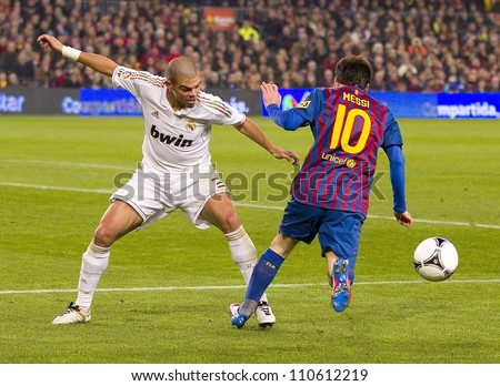 BARCELONA - JANUARY 25: Pepe Laveran (L) and Lionel Messi in action during the Spanish Cup match between FC Barcelona and Real Madrid, final score 2 - 2, on January 25, 2012, in Barcelona, Spain.