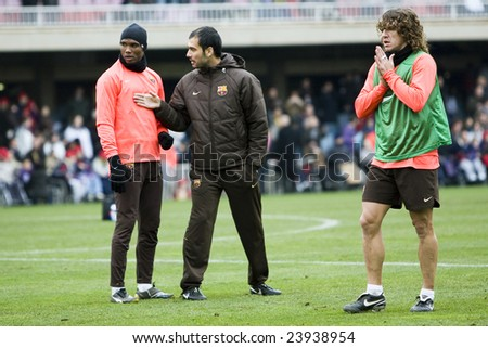 BARCELONA - JANUARY 7: The spanish soccer team FC Barcelona with the players Samuel Eto´o, Carles Puyol and the team coach Pep Guardiola during a training January 7, 2009 in Barcelona, Spain.