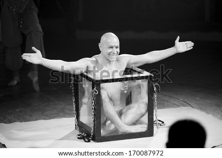 BARCELONA - JANUARY 1: Unidentified contortionist man performs during the new spectacle of Raluy Circus, on January 1, 2014 in Barcelona, Spain. - stock photo