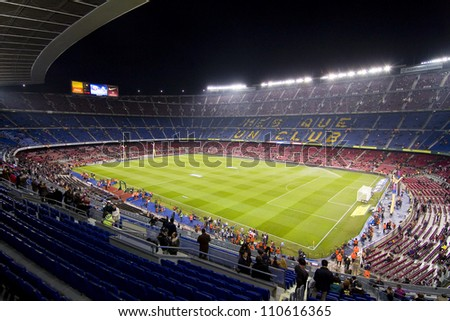 BARCELONA - JANUARY 25: Unidentified supporters during the Spanish Cup match between FC Barcelona and Real Madrid, final score 2 - 2, on January 25, 2012, in Camp Nou stadium, Barcelona, Spain. - stock photo