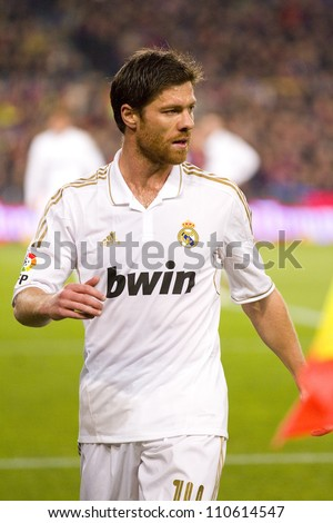 BARCELONA - JANUARY 25: Xabi Alonso of Madrid in action during the Spanish Cup match between FC Barcelona and Real Madrid, final score 2 - 2, on January 25, 2012, in Barcelona, Spain. - stock photo