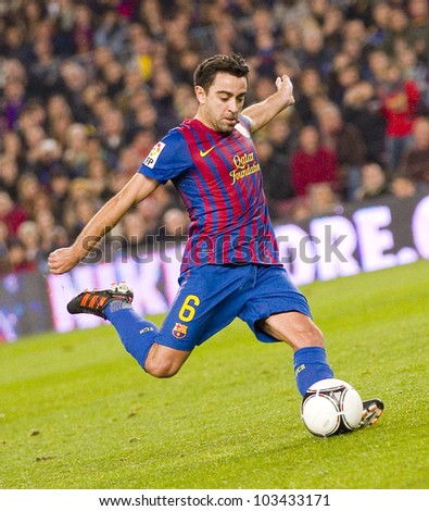 BARCELONA - JANUARY 4: Xavi Hernandez of Barcelona in action during the Spanish Cup match between FC Barcelona and Osasuna, final score 4 - 0, on January 4, 2012 in Camp Nou stadium, Barcelona, Spain.