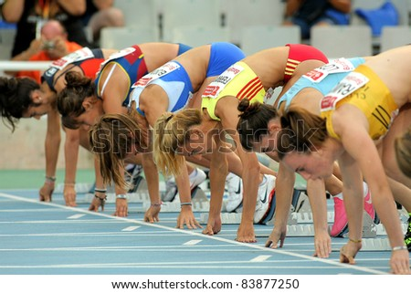 BARCELONA - JULY 22: Athletes ready on the start of 100m Event of Barcelona Athletics meeting at the Olympic Stadium on July 22, 2011 in Barcelona, Spain - stock photo