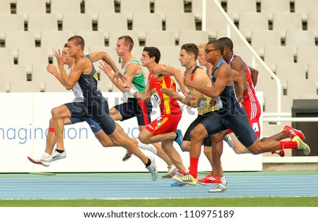 BARCELONA - JULY 10: Competitors on start of 100m of Decathlon  men during the 20th World Junior Athletics Championships at the Olympic Stadium on July 10, 2012 in Barcelona, Spain - stock photo