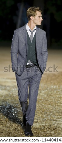 BARCELONA - JULY 11: French model Clement Chabernaud walks on the Mango catwalk during the 080 Barcelona Fashion runway on July 11, 2012 in Barcelona, Spain.