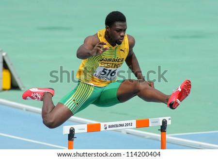 BARCELONA - JULY, 11: Jarvan Gallimore of Jamaica during 400m hurdles event of the 20th World Junior Athletics Championships at the Olympic Stadium on July 11, 2012 in Barcelona, Spain