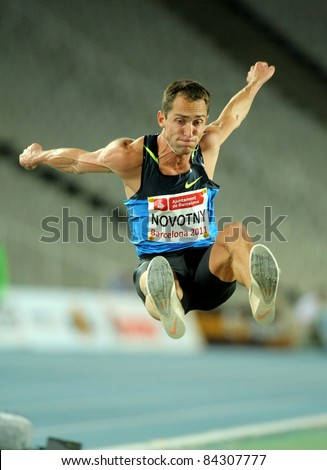 BARCELONA - JULY, 22: Roman Novotny of Czech Republic in action on Long Jump Event of Barcelona Athletics meeting at the Olympic Stadium on July 22, 2011 in Barcelona, Spain