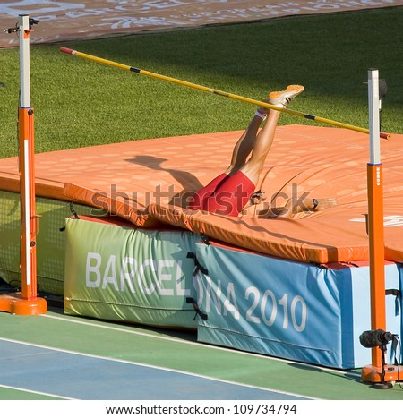 BARCELONA - JULY 28: Unidentified athlete compete at Decathlon High Jump during European Athletics Championships Barcelona 2010, on July 28, 2010 in Barcelona, Spain.