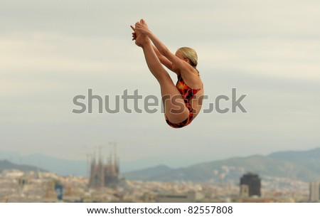 BARCELONA - JULY 24: unidentified diving athlete in action during a competition  of Barcelona diving trophy at Monjuich swimming pool July 24, 2011 in Barcelona, Spain