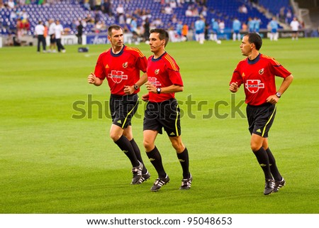 BARCELONA - JULY 27: Unidentified referees warm-up during the Ciutat de Barcelona match between Espanyol and Boca Juniors on July 27, 2011 in Cornella stadium, Barcelona, Spain. Final score, 3-1.