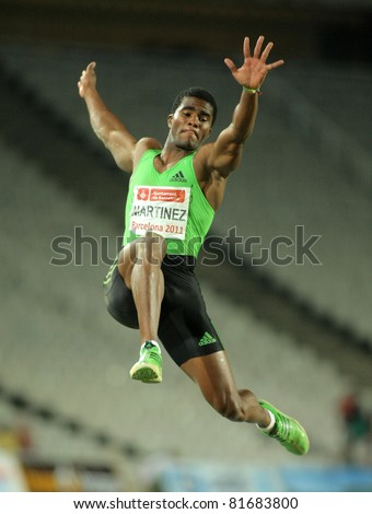 BARCELONA - JULY, 22: Wilfredo Martinez of Cuba in action on Long Jump Event of Barcelona Athletics meeting at the Olympic Stadium on July 22, 2011 in Barcelona, Spain - stock photo