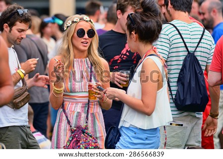 BARCELONA - JUN 12: Blonde woman from the audience at Sonar Festival on June 12, 2014 in Barcelona, Spain. #286566839