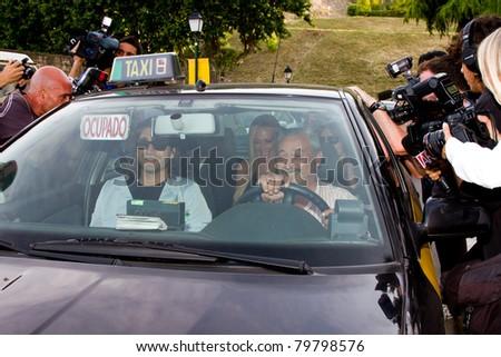 BARCELONA - JUNE 18: Belen Esteban (blond woman inside the car), a Spanish top celebrity, goes to the homosexual wedding of Luis Rollan, a famous journalist. June 18, 2011 in Alella, Barcelona, Spain.