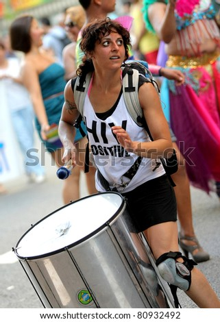 BARCELONA - JUNE 26: Drummer playing while parades during the annual Barcelona Gay and Lesbian Pride Festival through the city streets, June 26, 2011 in Barcelona, Spain