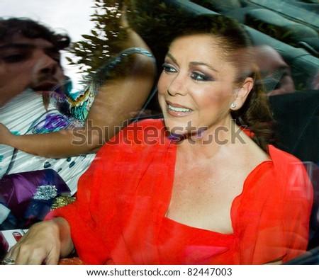 BARCELONA - JUNE 18: Isabel Pantoja, a popular Spanish flamenco bailaora or singer, goes to the wedding of Luis Rollan, a famous journalist. June 18, 2011, in Alella, Barcelona, Spain.