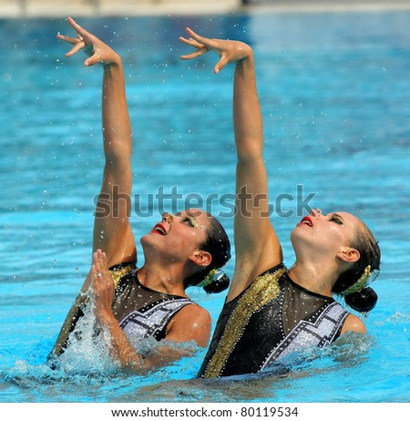 BARCELONA -JUNE 18: Mexican synchro swimmers Mariana Cifuentes and Isabel Delgado in a Duet exercise during the Espana Sincro meeting in Barcelona Picornell Swimpool, June 18, 2011 in Barcelona, Spain - stock photo