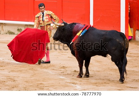 BARCELONA - JUNE 6: Morante de la Puebla in action during a corrida or bullfighting, typical Spanish tradition where a torero or bullfighter kills a bull. June 6, 2010 in Barcelona, Spain.