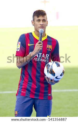 BARCELONA JUNE 3 Neymar Junior a FC barcelona new player poses for the photographers during his official presentation at the Camp Nou stadium on June 3 2013 in Barcelona Spain