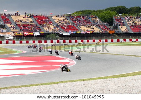 BARCELONA - JUNE 4: Some riders racing at Qualifying Session of Moto 125 Grand Prix of Catalunya, on June 4, 2011 in Barcelona, Spain.