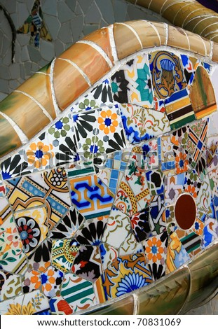 BARCELONA - JUNE 13: The surreal Parc Guell by Antoni Gaudi, one of Barcelona's most popular tourist attractions - Colorful park bench decorated with glazed ceramic mosaics June13, 2008 in Barcelona - stock photo