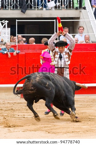 BARCELONA - JUNE 6: Unidentified Bullfighter perform during a corrida de toros or bullfight, typical Spanish tradition where a torero or bullfighter kills a bull on June 6, 2010 in Barcelona, Spain.