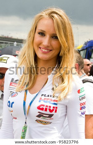 BARCELONA - JUNE 5: Unidentified Pit Babe of LCR Honda team poses for photos in the paddock during the Moto GP Grand Prix of Catalonia, on June 5, 2011 in Barcelona, Spain.