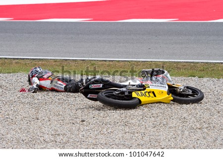 BARCELONA - JUNE 4: Unidentified rider have an accident at Qualifying Session of Moto 125 Grand Prix of Catalunya, on June 4, 2011 in Barcelona, Spain.