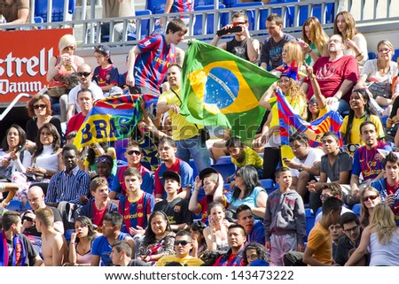 BARCELONA - JUNE 3: Unidentified supporters during Brazilian footballer Neymar Da Silva Santos Junior official presentation as new FC Barcelona player, on June 3, 2013, in Barcelona, Spain.