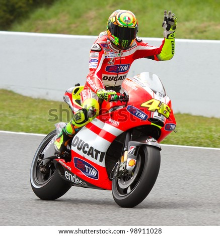 BARCELONA - JUNE 5: Valentino Rossi of Ducati celebrating his 5th position at the race of MotoGP Grand Prix of Catalunya, on June 5, 2011 in Barcelona, Spain.