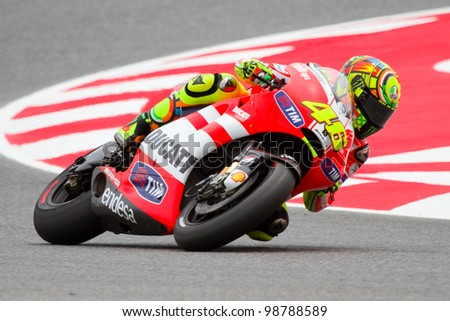 BARCELONA - JUNE 4: Valentino Rossi of Ducati team races at Qualifying Session of Moto GP Grand Prix of Catalunya on June 4, 2011 in Barcelona, Spain.