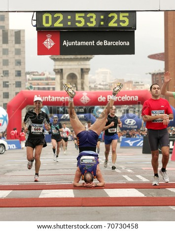 BARCELONA - MARCH 1: Athlete celebrating his record in acrobatic way at finish during Barcelona Marathon on March 1, 2009 in Barcelona, Spain