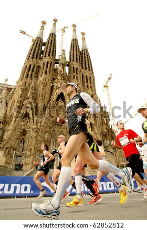 BARCELONA - MARCH 7: Athletes run in front of Sagrada Familia Cathedral in Barcelona Marathon on March 7, 2010 in Barcelona