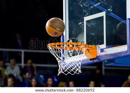 BARCELONA - MARCH 24: Ball inside the basket during the Euroleague basketball match between Barcelona and Panathinaikos, 71-75, on March 24, 2011 in Barcelona, Spain.