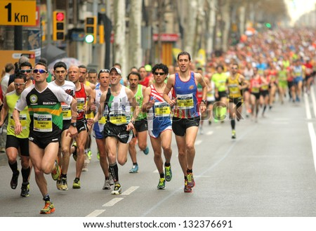 Barcelona - March, 17: Barcelona Street Crowded Of Athletes Running During Barcelona Marathon In Barcelona March 17, 2013 In Barcelona, Spain