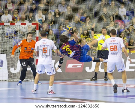 BARCELONA - MARCH 25: Jesper Noddesbo (3) in action during EHF Champions League match between FC Barcelona and Montpellier, final score 36-20, on March 25, 2012, in Palau Blaugrana, Barcelona, Spain.