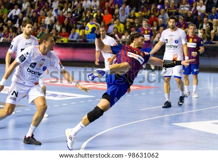 BARCELONA - MARCH 25: Jesper Noddesbo shoots a goal during EHF Champions League match between FC Barcelona and Montpellier, final score 36-20, on March 25, 2012, in Palau Blaugrana, Barcelona, Spain.