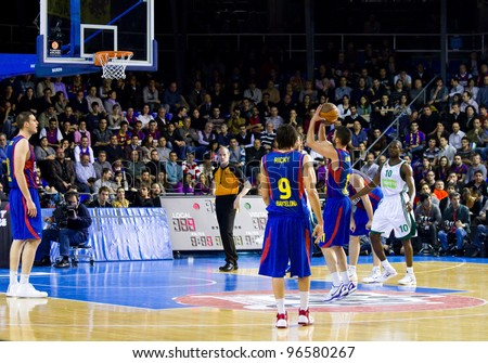 BARCELONA - MARCH 24: Juan Carlos Navarro shoots a point during the Euroleague basketball match between FC Barcelona and Panathinaikos, final score 71-75, on March 24, 2011 in Barcelona, Spain.