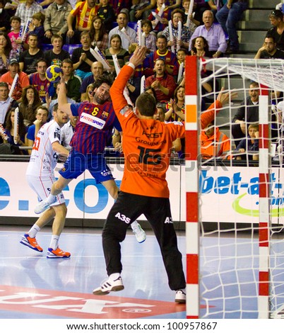 BARCELONA - MARCH 25: Juanin Garcia (6) in action during EHF Champions League match between FC Barcelona and Montpellier, final score 36-20, on March 25, 2012, in Palau Blaugrana, Barcelona, Spain.