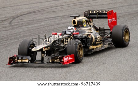 BARCELONA - MARCH 4: Kimi Raikkonen of Lotus Renault F1 team races during Formula One Teams Test Days at Catalunya circuit on March 4, 2012 in Barcelona, Spain.