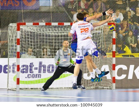 BARCELONA - MARCH 25: Nikola Karabatic (22) in action at EHF Champions League match between FC Barcelona and Montpellier, final score 36-20, on March 25, 2012, in Palau Blaugrana, Barcelona, Spain.