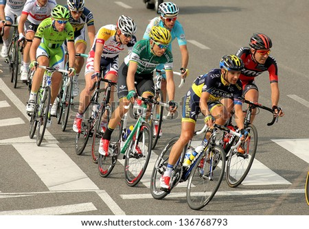 BARCELONA - MARCH, 24: Pack of the cyclists ride during the Tour of Catalonia cycling race through the streets of Monjuich mountain in Barcelona on March 24, 2013