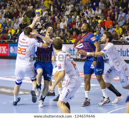 BARCELONA - MARCH 25: Players in action during EHF Champions League match between FC Barcelona and Montpellier, final score 36-20, on March 25, 2012, in Palau Blaugrana, Barcelona, Spain.